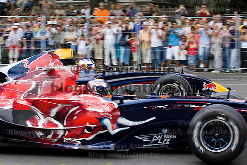 Red Bull Street Parade involving Formula 1 cars racing on public streets in central Budapest.