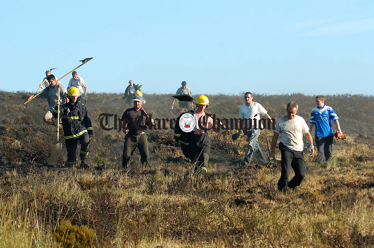 Members of the Ennis fire Brigade return after fighting a gorse fire with colleagues from Ennistymon and local people near The Hand in West Clare. Photograph by John Kelly.