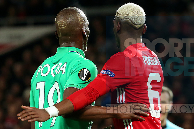 Florentin Pogba of Saint Etienne holds on to Paul Pogba of Manchester United during the UEFA Europa League Round of 32 1st leg match at Old Trafford Stadium, Manchester. Picture date: February 16th, 2017. Pic credit should read: Matt McNulty/Sportimage