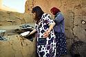 Syria 2000  <br /> Near Sorka, Jazira province, women cooking bred  <br /> <br /> Syrie 2000 <br /> Pres de Sorka, province de Djezireh, femmes cuisant le pain