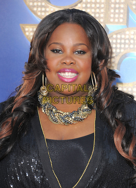 Amber Riley .attends The 20th Century Fox 'Glee 3D' Concert World Movie Premiere held at The Regency Village theatre in Westwood, California, USA, .August 6th 2011..portrait headshot black gold necklace smiling make-up pink  earrings  sequined sequin .CAP/RKE/DVS.©DVS/RockinExposures/Capital Pictures.