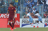 Calcio, Serie A: Lazio vs Roma. Roma, stadio Olimpico, 25 maggio 2015.<br /> Lazio's Filip Djordjevic, center, celebrates with teammate Luis Pedro Cavanda after scoring as Roma's Juan Iturbe, left, reacts during the Italian Serie A football match between Lazio and Roma at Rome's Olympic stadium, 25 May 2015.<br /> UPDATE IMAGES PRESS/Riccardo De Luca