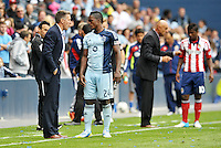 Peter Vermes Head Coach Sporting KC talks with Mechack Jerome..Sporting Kansas City defeated Chivas USA 4-0 at Sporting Park, Kansas City, Kansas.