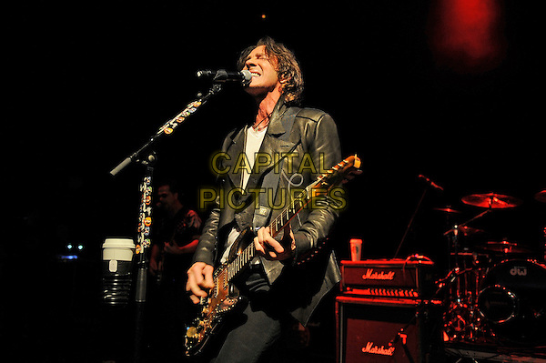 Rick Springfield <br /> performing in concert, Shepherd's Bush Empire, London, England. <br /> 4th June 2013<br /> on stage in concert live gig performance performing music half length black leather jacket guitar singing <br /> CAP/MAR<br /> &copy; Martin Harris/Capital Pictures