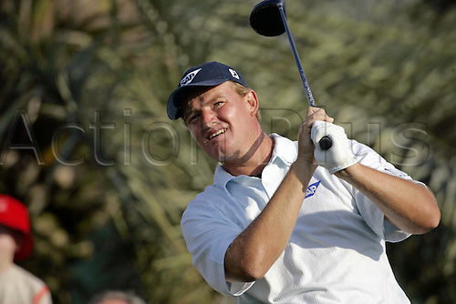 3 March 2005: South African golfer Ernie Els (RSA) looks into the distance after playing a driver from the 16th tee during round one of the Dubai Desert Classic held at the Emirates Golf Club, Dubai, United Arab Emirates. Photo: Neil Tingle/Action Plus..050303 male man men golf golfer golfers.