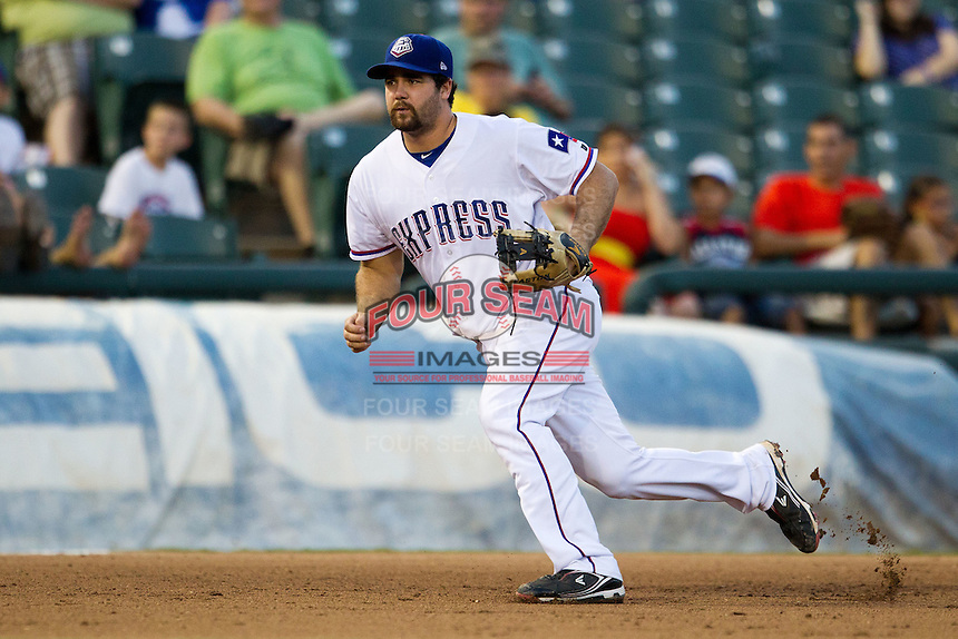 Round Rock Express third baseman Tommy Mendonca #24 on defense during the Pacific Coast League baseball game against the Omaha Storm Chasers on July 22, 2012 at the Dell Diamond in Round Rock, Texas. The Express defeated the Chasers 8-7 in 11 innings. (Andrew Woolley/Four Seam Images).