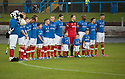 The Cowdenbeath team observe the minutes silence ...