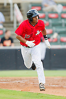 Cleuluis Rondon (13) of the Kannapolis Intimidators hustles down the first base line against the Delmarva Shorebirds at CMC-Northeast Stadium on August 8, 2013 in Kannapolis, North Carolina.  The Shorebirds defeated the Intimidators 4-3.  (Brian Westerholt/Four Seam Images)