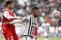 Calcio, Serie A: Juventus vs Carpi. Torino, Juventus Stadium, 1 maggio 2016.<br /> Juventus' Alex Sandro, right is challenged by Carpi's Stefano Sabelli during the Italian Serie A football match between Juventus and Carpi at Turin's Juventus Stadium, 1 May 2016.<br /> UPDATE IMAGES PRESS/Isabella Bonotto