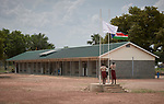 Students lower the flags at the end of a day at the Loreto Primary School outside Rumbek, South Sudan. The school is run by the Institute for the Blessed Virgin Mary--the Loreto Sisters--of Ireland.