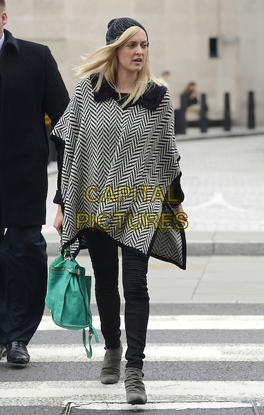 Fearne Cotton <br /> Spotted in London, England.<br /> October 1st, 2013<br /> full length black beanie hat white zig zag poncho top jeans denim ankle boots green bag purse <br /> CAP/IA<br /> &copy;Ian Allis/Capital Pictures