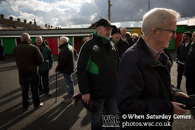 Glentoran 2 Cliftonville 1, 22/10/2016. The Oval, NIFL Premiership. Home supporters queueing for half-time draw tickets inside The Oval, Belfast before Glentoran hosted city-rivals Cliftonville in an NIFL Premiership match. Glentoran, formed in 1892, have been based at The Oval since their formation and are historically one of Northern Ireland's 'big two' football clubs. They had an unprecendentally bad start to the 2016-17 league campaign, but came from behind to win this fixture 2-1, watched by a crowd of 1872. Photo by Colin McPherson.