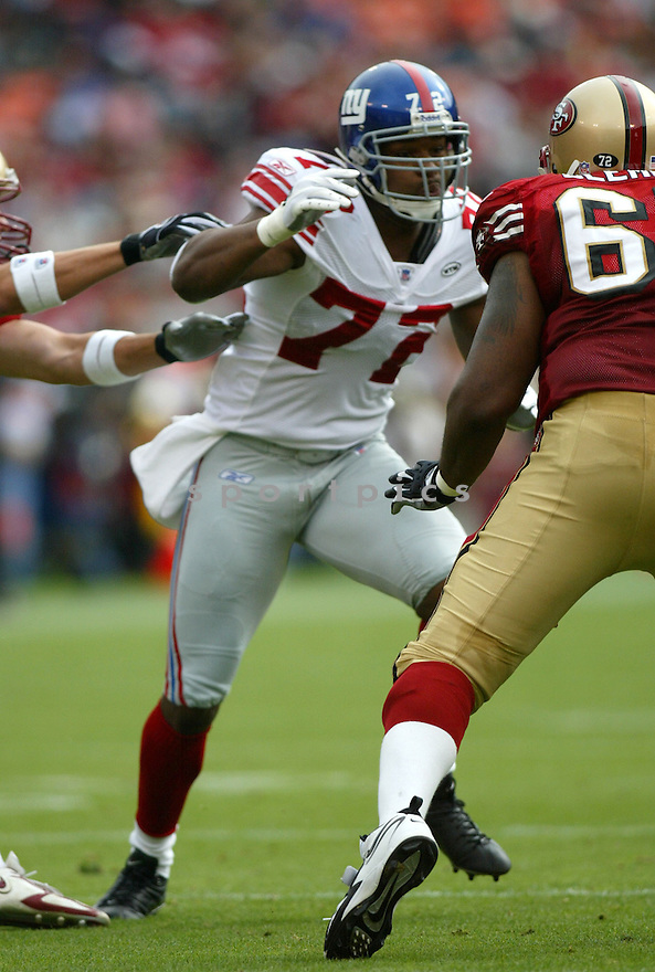Osi Umeyiora, of the New York Giants , in action against the San Francisco 49ers  on November 6, 2005...Chris Bernacchi / SportPics..Giants  wins 24-6
