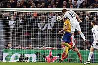 Harry Kane of Tottenham Hotspur sees his header cleared off the ;line by Andrea Barzagli of Juventus during Tottenham Hotspur vs Juventus, UEFA Champions League Football at Wembley Stadium on 7th March 2018