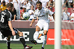 09 August 2009: Madrid's Cristiano Ronaldo (POR) takes a shot past DC's Greg Janicki (16). Real Madrid of Spain's La Liga played DC United of Major League Soccer at FedEx Field in Landover, Maryland in an international club friendly soccer match.