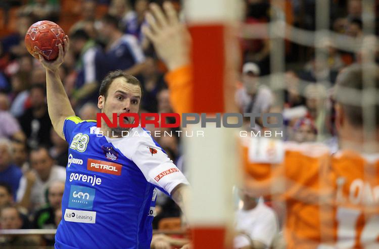Uros Zorman of Slovenia shoots the ball during the Men's EHF Euro 2012 Handball Championship match between Slovenia and France on January 22, 2012 at the Spens Hall of Novi Sad. <br /> <br /> Foto &copy;  nph / PIXSELL / Antonio Bronic