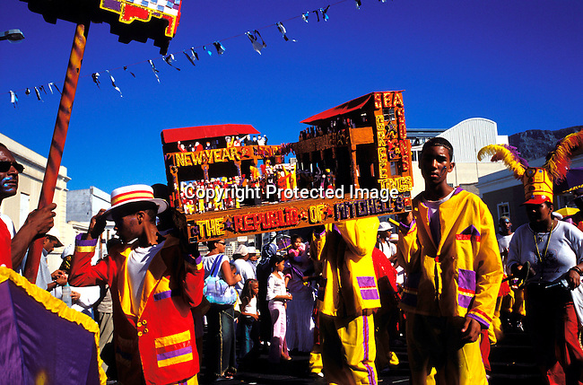 "dippcoo00045 .People. Coons.  Cape Minstrels CAPE TOWN, SOUTH AFRICA - JANUARY 2: Unidentified participans during the yearly ""Coon Carnival"" on January 2, 2003 in Cape Town, South Africa. The carnival performers are primarily mixed-race, or colored people and the carnival began in the early 19th century when slave bands played friendly competition during the annual Jan. 2 slave holiday. The parade has become a popular tourist attraction and the colorful floats are competing at a local stadium for days for the best costumes and performances..©Per-Anders Pettersson/ iAfrika Photos.."
