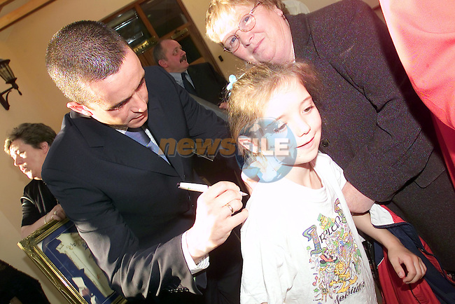 One young lucky girl Patrice Caffrey gets her Jersey signed by Gary Kally after he was made  a freeman of the Town of Drogheda...Picture Fran Caffrey Newsfile...This Picture is sent to you by:..Newsfile Ltd.The View, Millmount Abbey, Drogheda, Co Louth, Ireland..Tel: +353419871240.Fax: +353419871260.GSM: +353862500958.ISDN: +353419871010.email: pictures@newsfile.ie.www.newsfile.ie