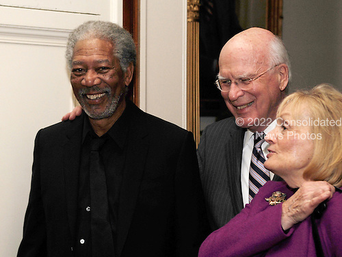 Actor Morgan Freeman, left, United States Senator Patrick Leahy (Democrat of Vermont), center, and his wife Marcelle Pomerleau arrive at an event, 'In Performance at the White House: A Celebration of Music from the Civil Rights Movement'  in the East Room of the White House in Washington, D.C. on Tuesday, February 9, 2010. .Credit: Alexis C. Glenn / Pool via CNP
