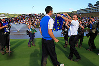 Ross Fisher and Miguel Angel Jiminez on the 18th green celebrate Europe winning after the Singles Matches during the Final Day of the The 2010 Ryder Cup at the Celtic Manor, Newport, Wales, 3rd October 2010..(Picture Eoin Clarke/www.golffile.ie)