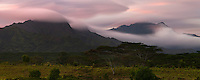 A purple sunset rendered abstract as the clouds stream over Mt. Waialeale and Mt. Kahili on Kauai