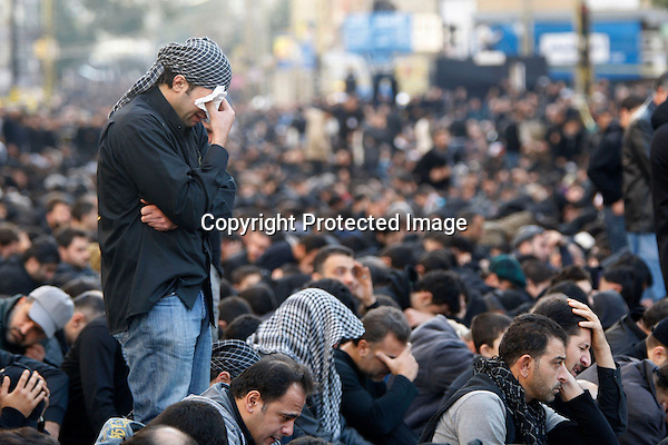 Lebanese Shiite Muslims mourn during a ceremony organised by the Shiite Hizbullah movement to mark the final day of Ashura in southern Beirut on December 27, 2009. Ashura is a Shiite religious event marked over ten days of mourning, commemorating the death of Prophet Mohammed's grandson Imam Hussein in the seventh century (680 AD) by the armies of the caliph Yazid in the battle of Karbala in central Iraq. (Photo by Salah Malkawi)