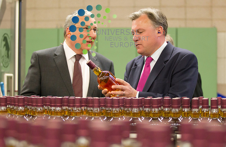 Labour's Shadow Chancellor, Ed Balls, with Dave McVittie (manufacturing manager) during a visit to Paisley Chivas Regal Whisky bottling plant, ahead of elections on Thursday. He will be discussing Labour's message for the European Elections and the independence referendum.<br /> Picture: Universal News And Sport (Scotland) 21 May 2014.