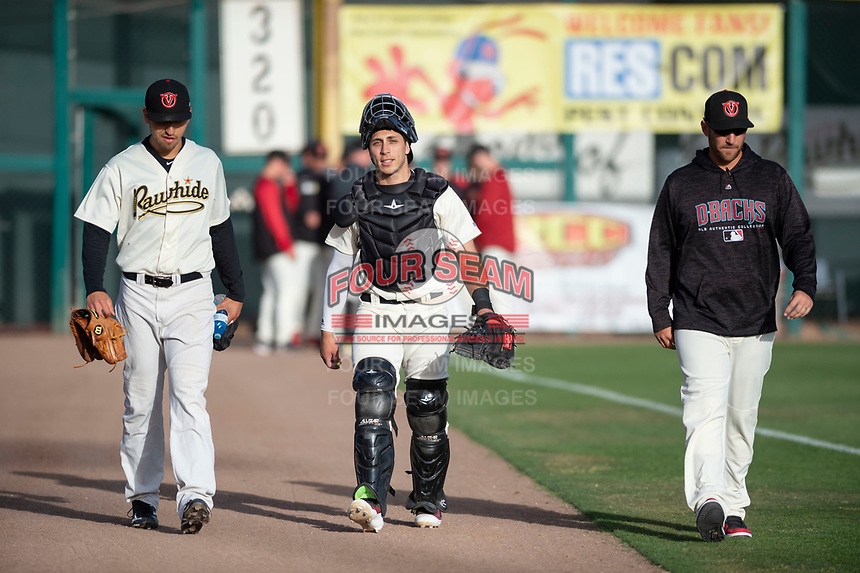 Visalia Rawhide starting pitcher Jeff Bain (20), catcher Renae Martinez (9), and pitching coach Shane Loux walk towards the dugout before a California League game against the Rancho Cucamonga Quakes on April 9, 2019 in Visalia, California. Visalia defeated Rancho Cucamonga 8-5. (Zachary Lucy/Four Seam Images)