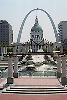 St. Louis: Gateway Arch framing Old Courthouse.  Downtown office buildings and water features in foreground. Photo '88.