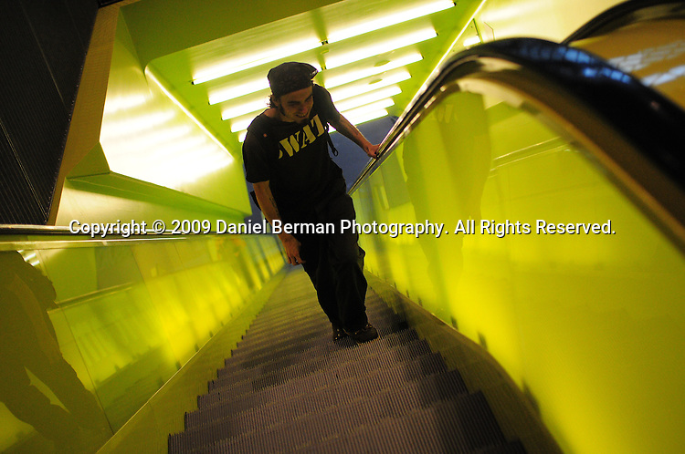A man takes the escalator inside the downtown Seattle Central Library. The 11-story building opened in 2004, and was designed by Rem Koolhaas. Photo by Daniel Berman/www.bermanphotos.com
