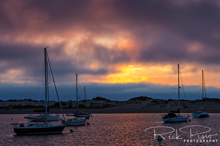 Sunset reflects off the water of Morro Bay along the California Coast