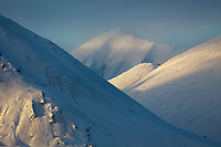 Sunrise on the freshly snow covered Brooks range mountains, arctic, Alaska.