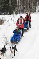 Gerald Sousa w/Iditarider on Trail 2005 Iditarod Ceremonial Start near Campbell Airstrip Alaska SC