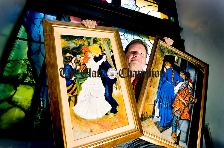 Painter Jack McCormack with his reproductions of a Renoir and a Burton which are hanging in the County Museum as part of his exhibition Old Masters.Pic Arthur Ellis.