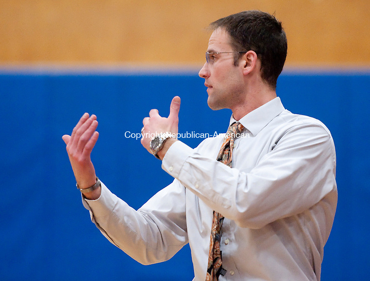 BURLINGTON, CT--- -030816JS14- Watertown head coach Ed Sakl calls out a play during their Class M first round game against Lewis Mills Tuesday at Lewis S. Mills High School in Burlington. <br /> Jim Shannon Republican-American