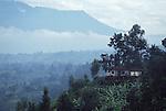 House in the foothills of the Virunga range of volcanoes on the border betwen Rwanda.