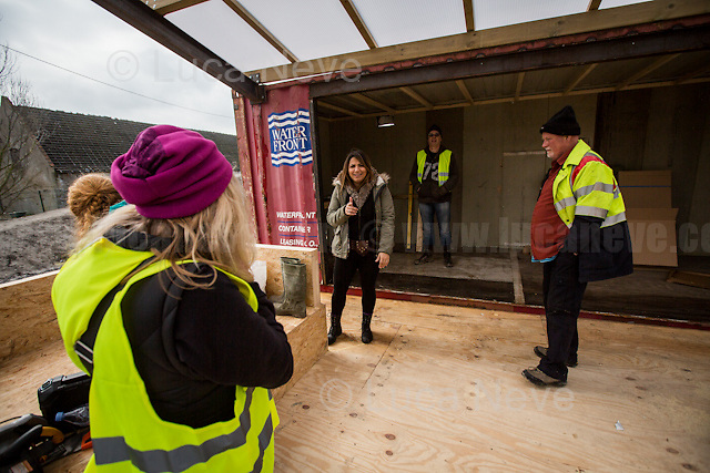 """Work in progress: one of the new kitchens.<br /> <br /> Dunkirk Camp.<br /> <br /> Under the Sky of Calais & Dunkirk. Two Camps, Two Sides of the Same Coin: Not 'migrants', Not 'refugees', just Humans.<br /> <br /> France, 24-30/03/2016. Documenting (and following) Zekra and her experience in the two French camps at the gate of the United Kingdom: Calais' """"Jungle"""" and Dunkirk's """"Grande-Synthe"""". Zekra lives in London but she is originally from Basra in Iraq. Zekra and her family had to flee Kuwait - where they moved for working reason - due to the """"Gulf War"""", and to the Western Countries' will to """"export Democracy in Iraq"""". Zekra is a self-motivated volunteer and founder of """"Happy Ravers"""", a group of people (not a NGO or a charity) linked to each other because of their love for rave parties but also men and women who meet up every week to help homeless people and other people in need in Central London. (Here there are some of the stories I covered about Zekra and """"Happy Ravers"""": http://bit.ly/1XVj1Cg & http://bit.ly/24kcGQz & http://bit.ly/1TY0dPO). Zekra worked as an English teacher in the adult school at Dunkirk's """"Grande-Synthe"""" camp and as a cultural mediator and Arabic translator for two medic teams in Calais' """"Jungle"""". Please read her story at the beginning of this reportage."""