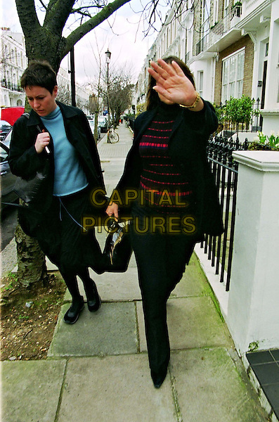 LIZ HURLEY.Liz Hurley, Who Is Expecting Her Baby In April, Leaving Her Fulham Home With Her Assistant To Go To The Fetal Medical Centre In Harley Street..paparazzi picture, walking, covering face, black coat, hand up, full length, full-length.www.capitalpictures.com.sales@capitalpictures.com.© Capital Pictures