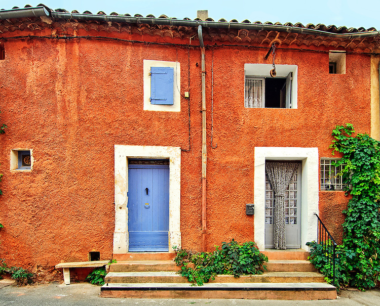 House façades in the Luberon village of Roussillon exhibit stucco walls made from red and yellow ochre extracted from the local quarries.