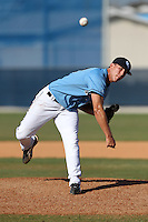 SCF Manatees pitcher Steven Leasure #12 delivers a pitch during a game vs. Indian River State College at Robert C. Wynn Field in Bradenton, Florida;  February 22, 2011.  SCF defeated Indian River 3-0.  Photo By Mike Janes/Four Seam Images