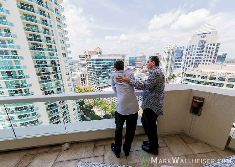 Michael Higer with his son Adam at their home in Ft. Lauderdale, Florida.
