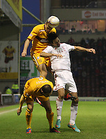 Fraser Kerr climbs above Rory Fallon and teammate Tom Hateley in the Motherwell v Aberdeen, Clydesdale Bank Scottish Premier League match at Fir Park, Motherwell on 26.12.12.