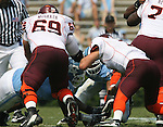 09 September 2006: North Carolina recovers a first quarter fumble by Virginia Tech's Sean Glennon (7). The University of North Carolina Tarheels lost 35-10 to the Virginia Tech Hokies at Kenan Stadium in Chapel Hill, North Carolina in an Atlantic Coast Conference NCAA Division I College Football game.