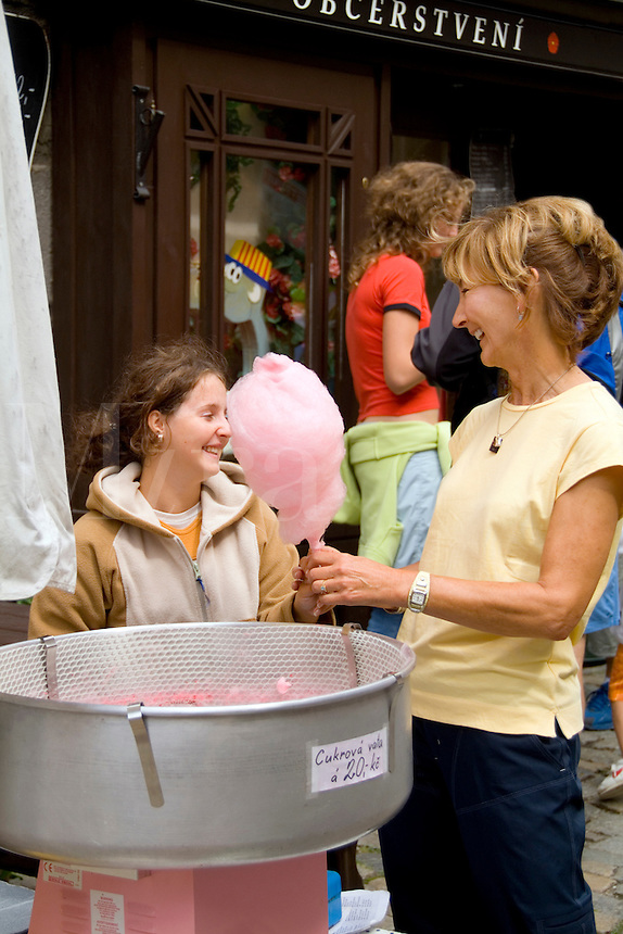 Tourist sharing cotton candy with vendor, Cesky Krumlov, Czech Republic