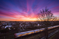 UNITED KINGDOM, London: 13 Jan 2016 The sun starts to rise on yet another beautiful January morning as a passing London Underground carriage sails past in Southfields, South West London. Rick Findler / Story Picture Agency