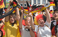 Germany, DEU, Dortmund, 2006-Jun-24: FIFA football world cup (USA: soccer world cup) 2006 in Germany; German football fans in good mood at a public viewing zone before the world cup match Germany vs. Sweden (2:0).