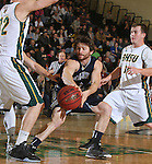 SPEARFISH, SD - DECEMBER 3, 2015 -- Philip Schanilec #3 of South Dakota Mines passes between Black Hills State defenders Riley Ryan #32 and Wyatt Krogman #11 during their college basketball game Saturday at the Donald E. Young Center in Spearfish, S.D. (Photo by Dick Carlson/Inertia)