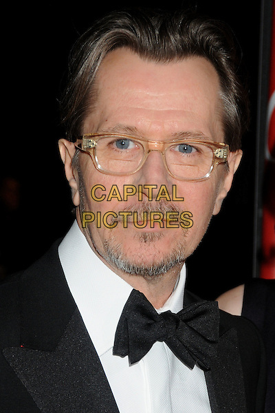 Gary Oldman.2012 Palm Springs International Film Festival held at the Palm Springs Convention Center, Palm Springs, California, USA, .7th January 2012..arrivals portrait headshot  glasses beard goatee facial hair black bow tie .CAP/ADM/BP.©Byron Purvis/AdMedia/Capital Pictures.