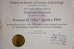 An award received by forensic dentist Dr. Norman Skip Sperber seen in his home in San Diego, California August 3, 2015. <br /> (Photo by Kendrick Brinson)