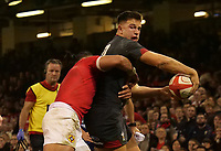 Wales' Owen Watkin offloads while under pressure from Tonga's Sonatane Takulua<br /> <br /> Photographer Ian Cook/CameraSport<br /> <br /> Under Armour Series Autumn Internationals - Wales v Tonga - Saturday 17th November 2018 - Principality Stadium - Cardiff<br /> <br /> World Copyright © 2018 CameraSport. All rights reserved. 43 Linden Ave. Countesthorpe. Leicester. England. LE8 5PG - Tel: +44 (0) 116 277 4147 - admin@camerasport.com - www.camerasport.com
